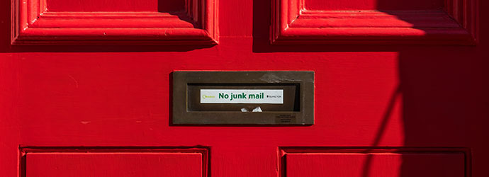 Red door with No Junk Mail sign